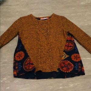 A colorful patterned sweater